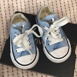 9c5811aab9a1 Converse infant low top sneakers in light blue.